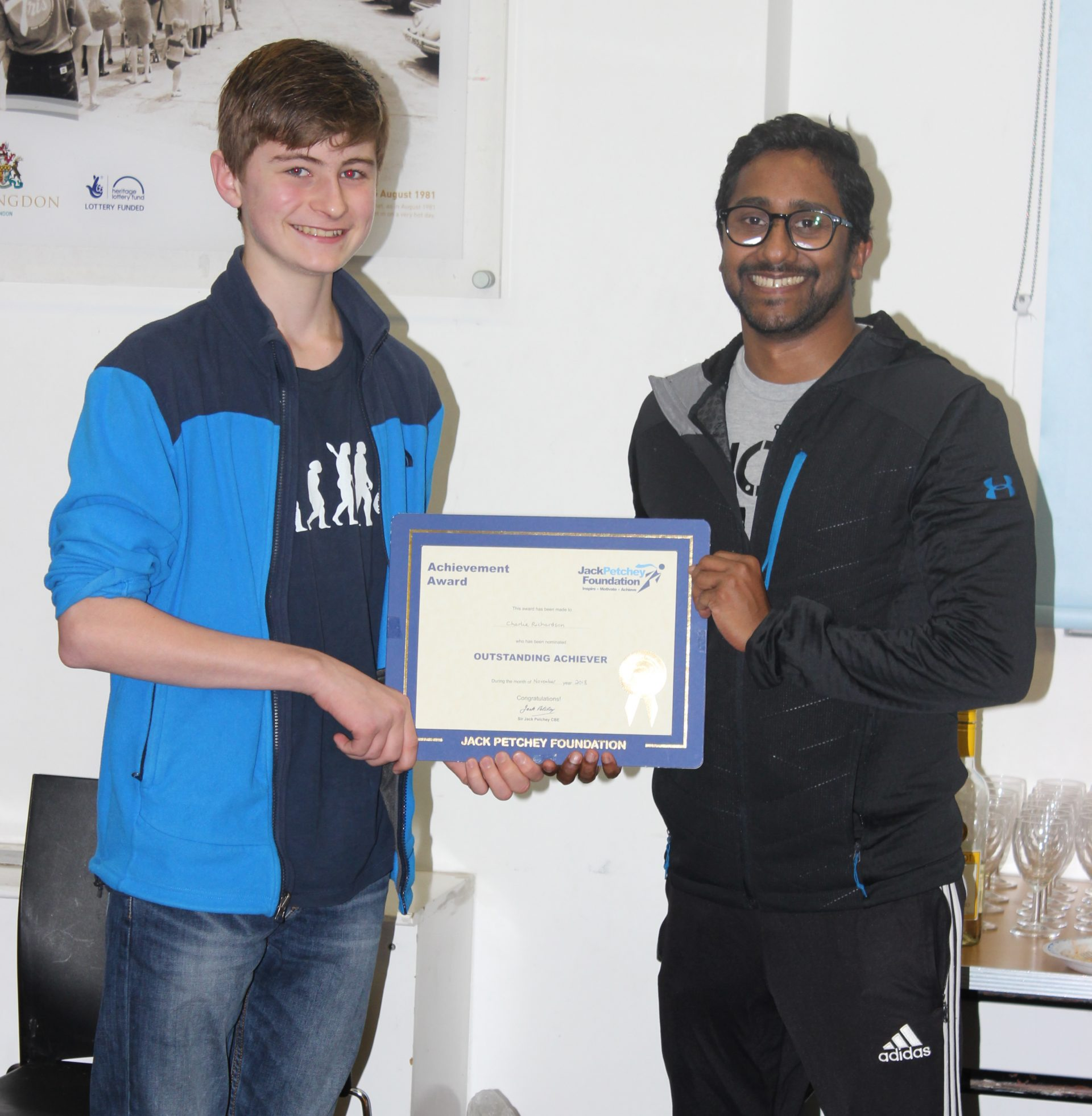 Charlie receiving his award from coach Aloka.