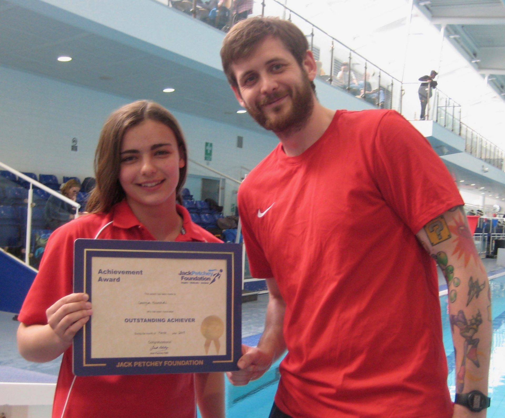 Georgia receiving Award certificate