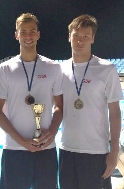 Elliot and Toby with their bronze medals and trophy