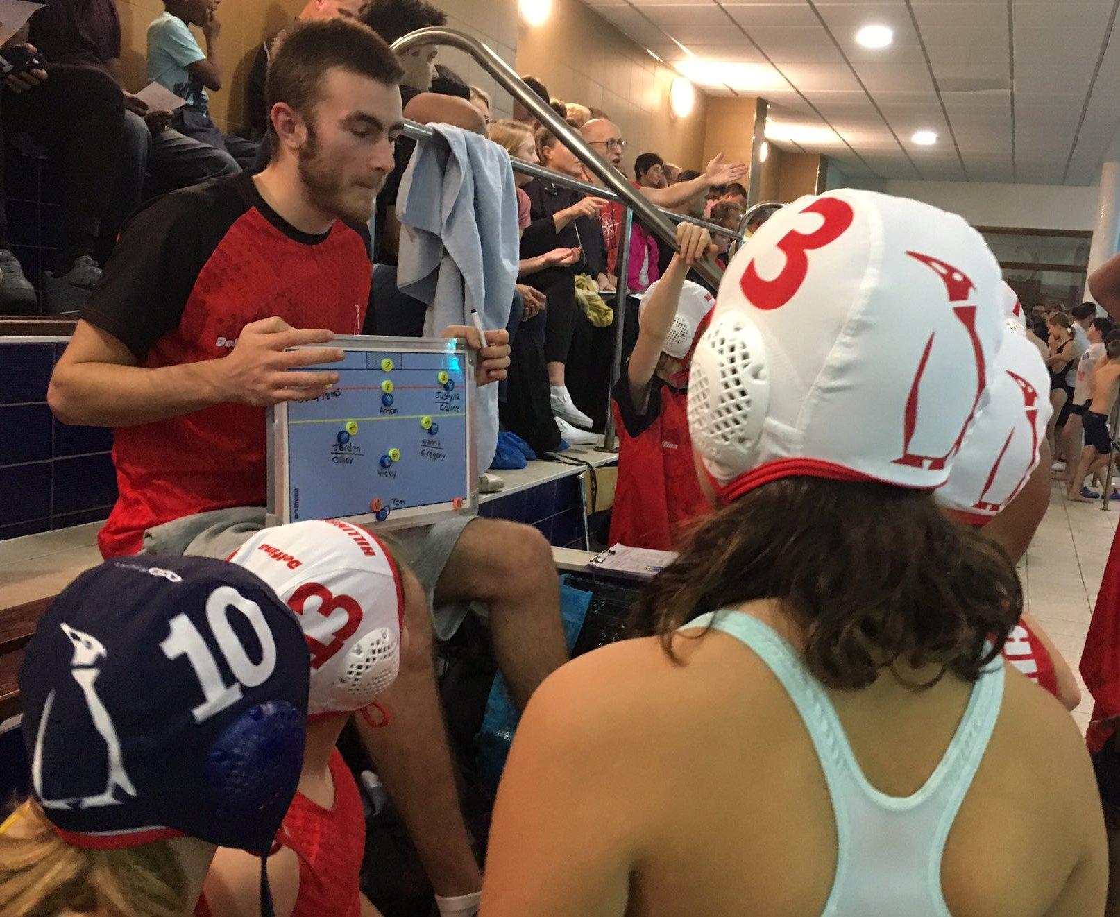 Coach Mickey sharing team tactics
