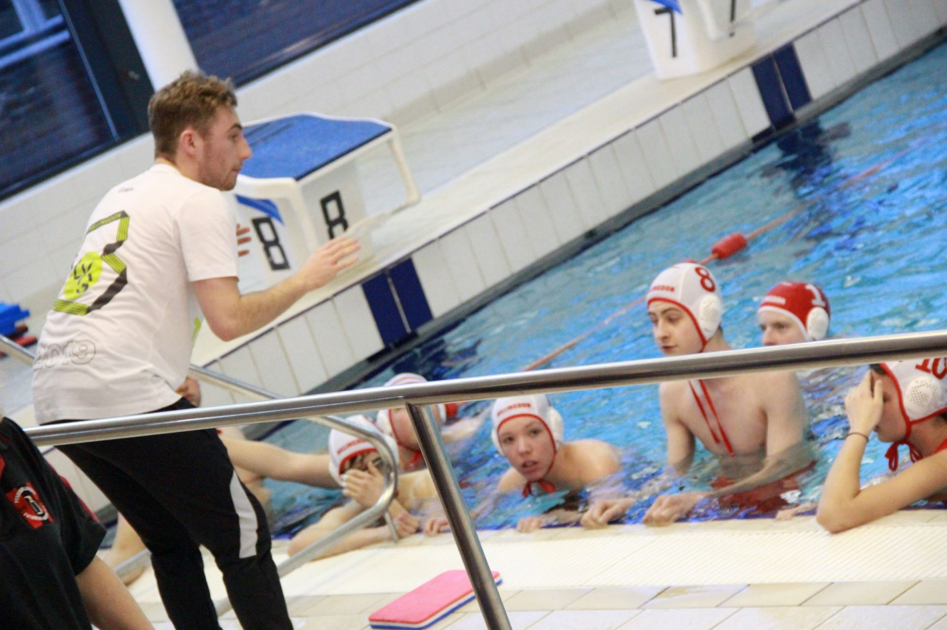 Adma Maidment coaching on the poolside