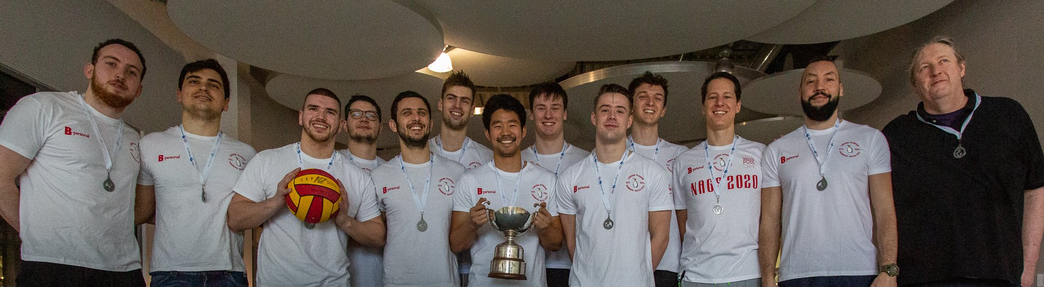 Penguin mens water polo team holding trophy
