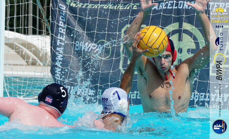 Water polo player shooting at goal with Elliot McHugh as goalie