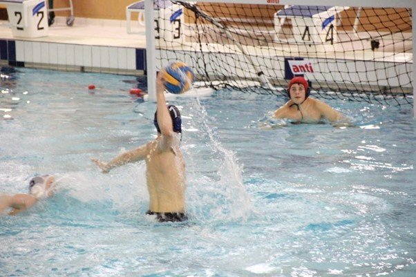 Water polo player shooting at goal