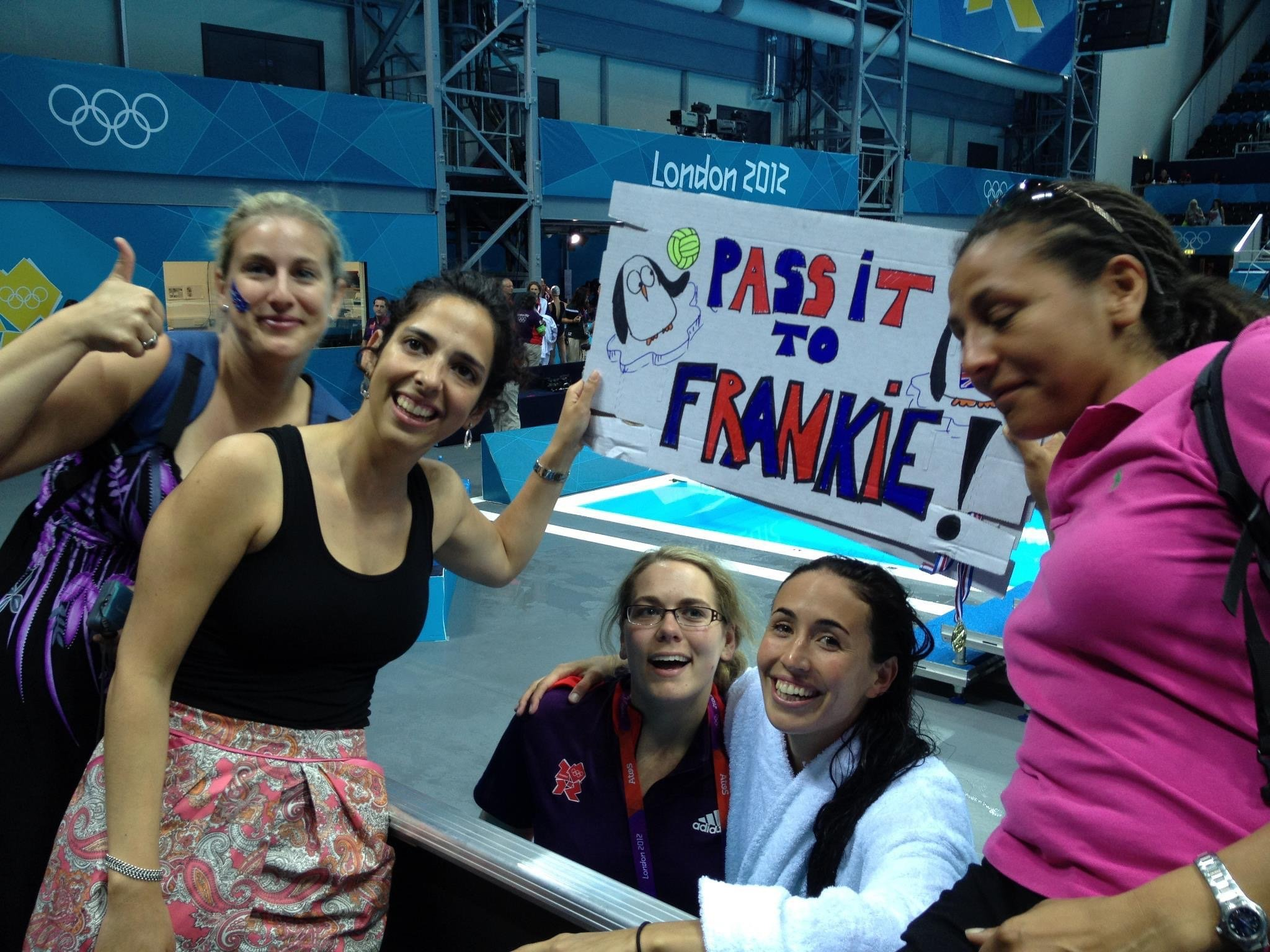 Spectators with a banner supporting Frankie Snell